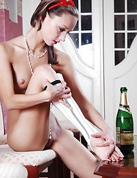 Petite teen girl playing with the bottle of bubbly