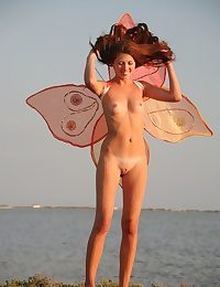 Hot remarkable girl posing naked with butterfly wings