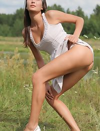 Selesta spreads her legs surrounding open beside flexible poses as she debuts her gorgeous athletic develop intensify beside a grassy breadth by the river.